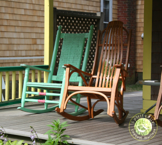 SUM rocking chairs with SUM logo